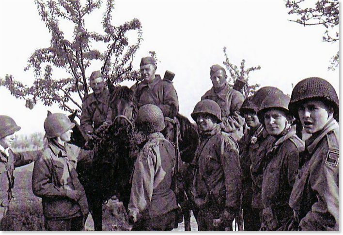 Figure 8. Craig Patrol 1645 (4:30 PM). Major Fred W. Craig, Hq Co 2nd B 273rd Inf Rgt, second from the left, reaches out to a Soviet soldier on his horse. His patrol had been searching for the Kotzebue patrol when it encountered the Russians at Clanzschwitz at 1645 April 25, 1945.